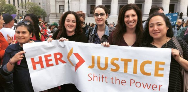 her justice staff with a banner